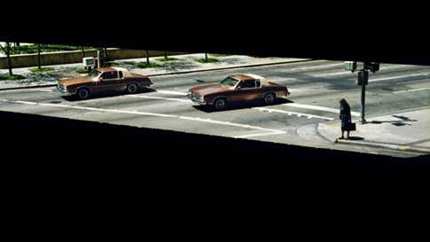 Two Cars and A Woman Waiting