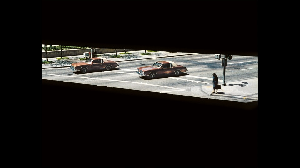 Two Cars and A Woman Waitingby Wim Wenders