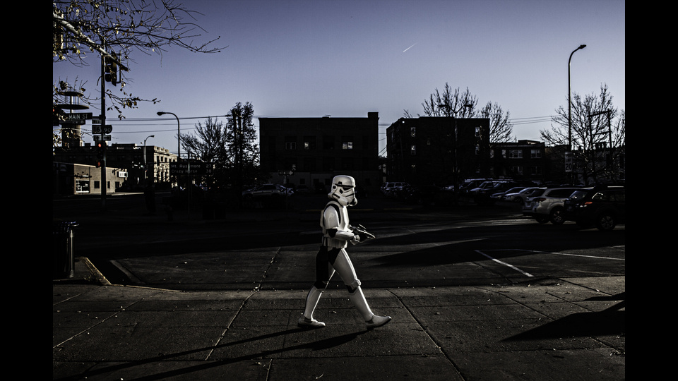 A masked man crosses the street - Rapid City SD 2013by Luca Sidro
