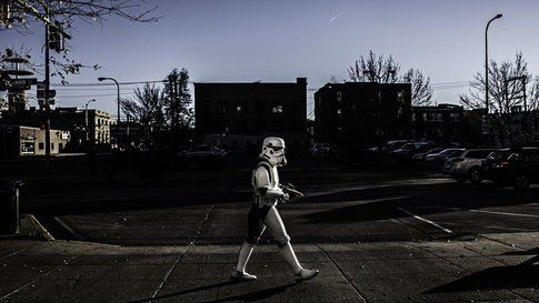 A masked man crosses the street - Rapid City SD 2013